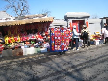 On our way back to the tour bus, local vendors urge us to buy their  merchadise at the Summer Palace.